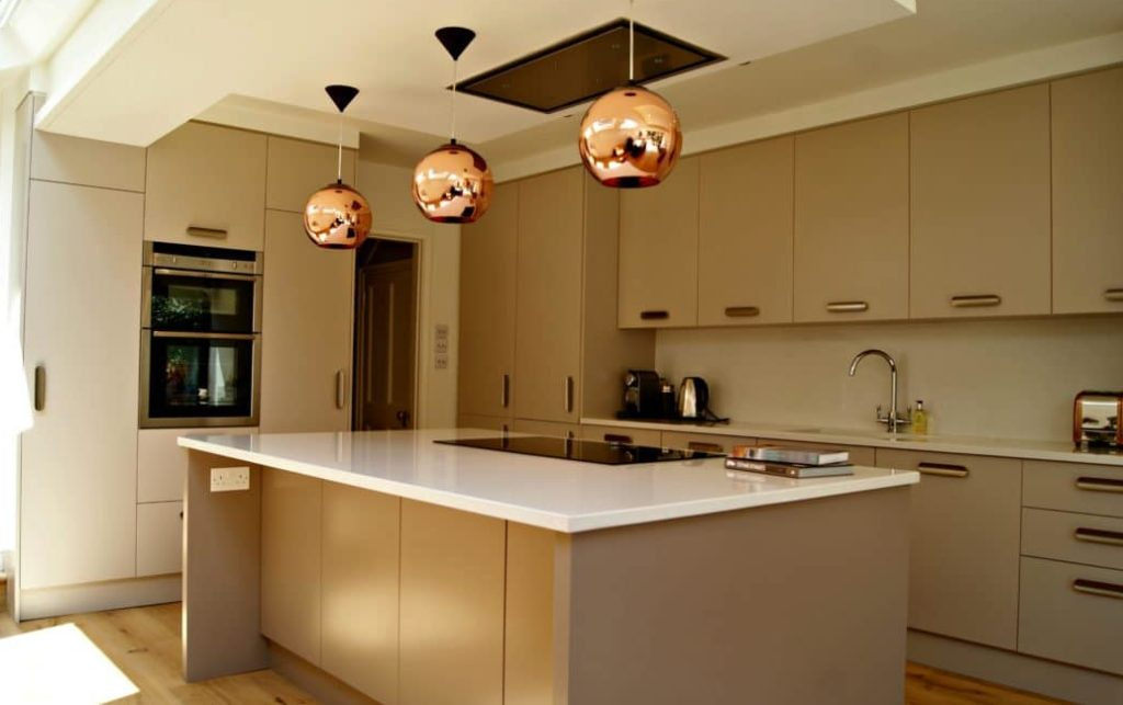 Kitchen with induction hob on island and ceiling extractor